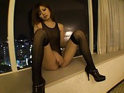 Rina Kato Asian rubs her clit all in black stockings and body