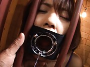 Japanese AV Model has mouth caught in machine behind the bars