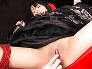 Hikaru Momose tied up with her stocking clad legs spread wide