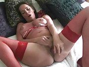 Marlyn strips out of red lingerie and stockings before playing with her pussy