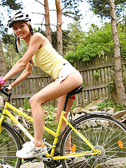 Sweet and natural teen Pinky June riding bike and posing naked