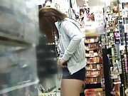 Japanese AV Model plays with her cunt in a store on spycam