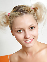Blond and blue-eyed teen Pinky June absolutely naked in bath!