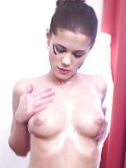 Oiled-up Caprice pours a lot of oil on her buddy