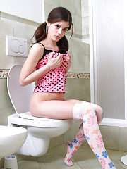 Naughty Caprice posing in the toilet room