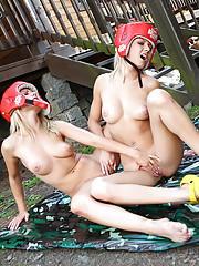 Young and horny teen Pinky June dressed as boxer in lesbo action