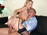 A beauty wearing stockings fucks a big boner
