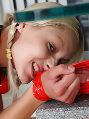 Blond and blue-eyed teen Pinky June get her body tied with sticky stripe