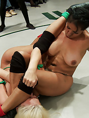 4 sexy female wrestlers battle on the mat in front of live audience!