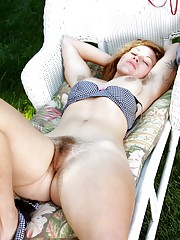 Lilah rubs her hairy pussy outdoors