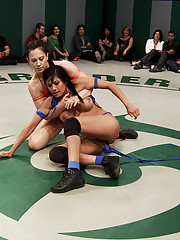 Harsh submission holds, face sitting, pussy fingering, and sexual abuse on the wrestling mat!