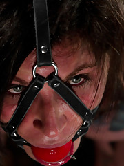 Blue eyed, big tits, tattooed fantasy girl Kathryn submits to bizarre leather encasement bondage, suspension, wicked intense orgasms, and pain.