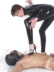 Latex catsuit domme