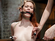 Top girl/girl porn starlet Justine Joli endures a wicked steer tie suspension, challenging hogtie, cums repeatedly and begs for more!