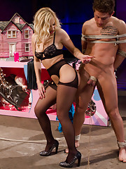 Ashley Fires commands two of her slaves to suck each others cocks for her amusement!