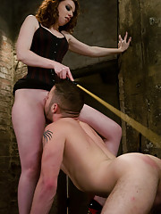 Beautiful Red Head Dominatrix teases and beats slave cock