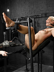Beautiful, blonde haired and blue eyed Anikka gets pushed with a straight jacket hogtie, pile driver suspension, and spread eagle fucking machine.