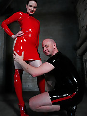 Claire Adams fucks latex slave with electric ass plug