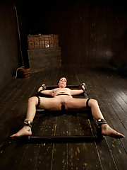 Bound onto a metal H-Frame with leather, Bryn gets her first taste of the cattle prod and pushed to her limits in the last part of her live show.