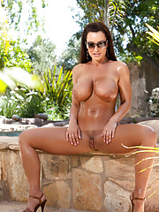 Sexy Lisa Ann flaunting her massive tits while fucking herself with a dildo