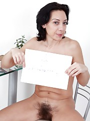 Perky hairy girl Eva flashes a smile and more