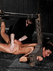 Beretta James is subjected to heavy encasement, suspension bondage, fear play, hot wax, nipple torment, wooden stocks, and intense orgasms.