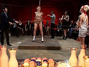 Kristine Kahill is smothered in sweets and turned into dessert for a crowd of armory regulars. Fucked hard in the mouth and pussy!