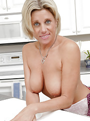 Soccer mom loses her apron and washes her small tits and pussy in the sink