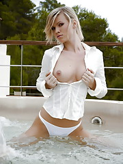 Marketa Belonoha frolics around in a fountain outside