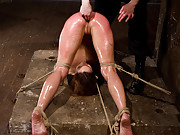 Glistening in oil, ripe cunt Amber gets bound tightly in pile driver, fisted anally, double penetrated, and beat hard on the ass.