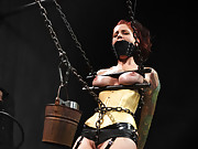 Beautiful in latex and chains, Tricia gets her head dunked in water while getting zapped with electricity.Nipple torment, single-tail, pussy pounding