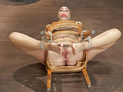Chanel is given a booty tie to pop her ass out, oiled up like Sunday dinner, bound to a chair on her back like the whore she is & fucked into oblivion