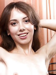 Erika strips naked at home showing her hairy pussy