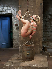 Squirter Sheena Shaw gets broken in at Kink HogTied style with a straddle split inverted suspension, ankle/neck ebi suspension, open ball tie & more.
