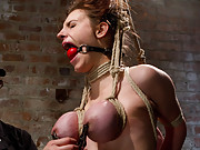 Iona submits to a day of harsh breast bondage, hogtie rope suspension, sybian, predicament bondage, partial breast suspension, and suction tubes!