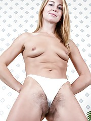 Melisa uses cell phone on hairy pussy