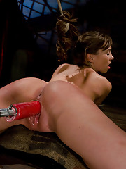 Capri Anderson gets tied in inescapable bondage, and fucked like she