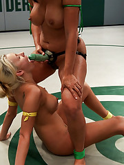 Big tits face off on the mat! Watch now to see who spends the day pinned and helpless, struggling to get the fingers out of her cunt!