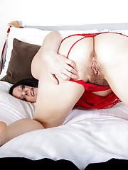 Amber Lustful shows off her hairy pussy in red