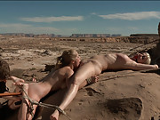 A twisted love triangle lands Penny and Cherry bound unimaginable areas of the desert in extreme bondage games.
