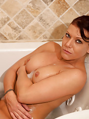 Wet Anilos pinup caresses her body in the bathtub