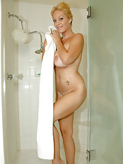 Naughty milf lathers up her huge tits in the shower
