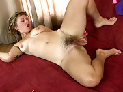 Nympho Lilah slides fingers inside hairy pussy