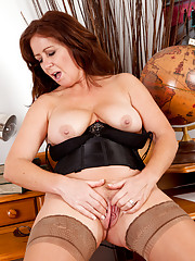 Redhead milf teases her cock hungry pussy