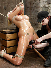 Blonde bimbo Katie learns the challenges of the prisoner tie in an intense back arch and is repeatedly challenged with corporal and tough predicaments