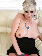 Sizzling cougar Dimonte exposes her natural tits