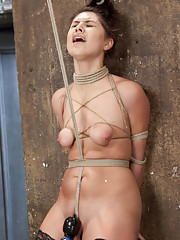 Scarlet Banks endures painful crotch rope orgasms, clothespin zipper in an inverted spread eagle suspension, and her nipples bound to her toes.