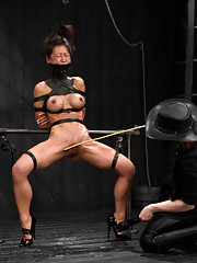 Asian hottie Tia returns to Device for UNBELIEVABLE torment kneeling on rice, bound leather grand plié in heels, and four fingers in each hole. DIRTY