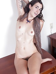 Artemis plays dress up and shows her hairy pussy