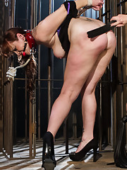 Big Boobs, round ass submits to tough lesbian dominatrix with spanking, suspension bondage and squirting.